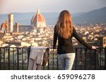 girl looking at the city of... | Shutterstock . vector #659096278