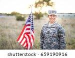 Happy Female Soldier In Desert...