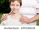 fathers hand's on son's... | Shutterstock . vector #659230618