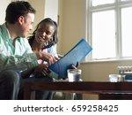 couple reading folder in living ... | Shutterstock . vector #659258425