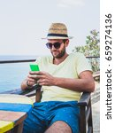 young man using a smartphone on ...   Shutterstock . vector #659274136