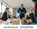 proud company leader speaker at ... | Shutterstock . vector #659282986