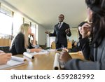 business people attentive... | Shutterstock . vector #659282992