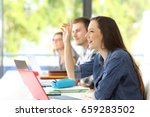 side view of a student raising... | Shutterstock . vector #659283502