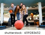 friends having fun while bowling | Shutterstock . vector #659283652
