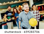 friends bowling at club   Shutterstock . vector #659283706