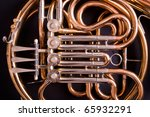 French Horn on dark background - stock photo
