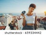 serious attractive afro... | Shutterstock . vector #659334442