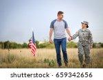 Husband And Army Wife Walk...