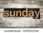 "the word ""sunday"" written in... | Shutterstock . vector #659351596"