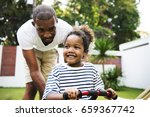 african descent father teaching ... | Shutterstock . vector #659367742