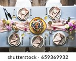 wedding reception table setting | Shutterstock . vector #659369932