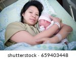 cute newborn baby and mother... | Shutterstock . vector #659403448