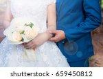 groom hugging his bride whit... | Shutterstock . vector #659450812