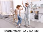 cute young couple dancing at... | Shutterstock . vector #659465632