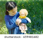 little girl playing with hand... | Shutterstock . vector #659481682