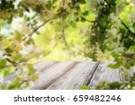white rustic wooden table over... | Shutterstock . vector #659482246