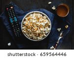 bowl of popcorn with salted... | Shutterstock . vector #659564446