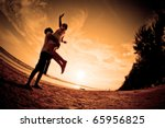 happiness and  romantic Scene of love couples partners on the Beach - stock photo