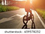 girl in helmet riding a bike on ... | Shutterstock . vector #659578252