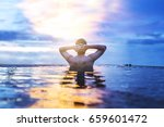 a man relax in the water under... | Shutterstock . vector #659601472