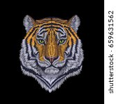 tiger head noble staring. front ... | Shutterstock .eps vector #659631562