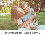 mother and daughter sitting on... | Shutterstock . vector #659638942