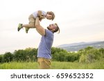 a father and son having fun... | Shutterstock . vector #659652352