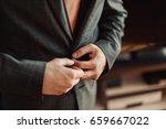 groom dresses a suit  | Shutterstock . vector #659667022