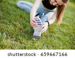 athletic girl stretches and... | Shutterstock . vector #659667166