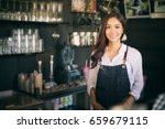 asian women barista smiling and ... | Shutterstock . vector #659679115