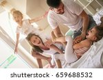 happy family playing together... | Shutterstock . vector #659688532