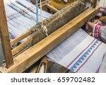 slavic linen on loom  woman...   Shutterstock . vector #659702482