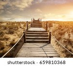 wooden walkway over the sand... | Shutterstock . vector #659810368