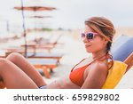 young woman sunbathing on the...   Shutterstock . vector #659829802