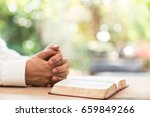 the man hands praying with a... | Shutterstock . vector #659849266