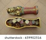 Egyptian Sarcophagus With Coins