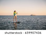 attractive young girl stand up... | Shutterstock . vector #659907436