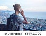 man traveler with backpack... | Shutterstock . vector #659911702
