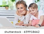 mother and son looking at... | Shutterstock . vector #659918662