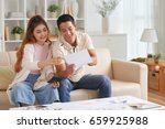 portrait of young asian couple... | Shutterstock . vector #659925988