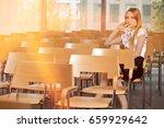 businesswoman contemplating at... | Shutterstock . vector #659929642