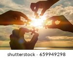 collaborate four hands trying... | Shutterstock . vector #659949298