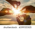 collaborate four hands trying... | Shutterstock . vector #659955505