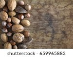 brazil nuts  walnuts  almonds... | Shutterstock . vector #659965882
