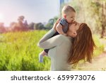 happy mother with her beloved...   Shutterstock . vector #659973076