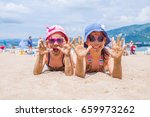 little girls  lying on a sandy... | Shutterstock . vector #659973262