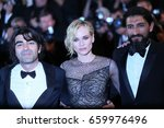 Small photo of Faith Akin, Diane Kruger, Numan Acar attend the 'In The Fade (Aus Dem Nichts)' premiere during the 70th Cannes Film Festival at Palais on May 26, 2017 in Cannes, France.