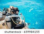scuba diver before diving.... | Shutterstock . vector #659984155