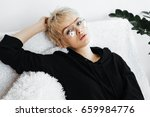 beautiful young adult blonde... | Shutterstock . vector #659984776